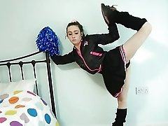 Flexible cheerleader poses naked...